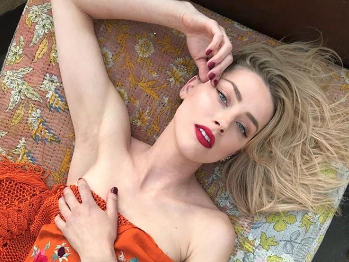 Amber Heard dan Cara Delevingne