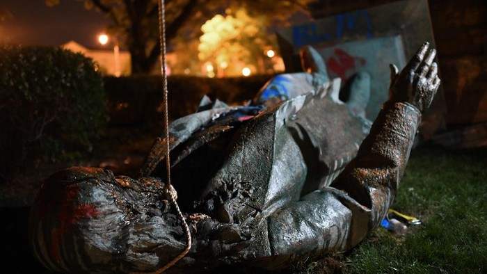 The statue of Confederate general Albert Pike is pictured after it was toppled by protesters at Judiciary square in Wahsington, DC on late June 19, 2020. - Protesters have toppled the only statue of a Confederate general in the US capital, images broadcast by US media show.