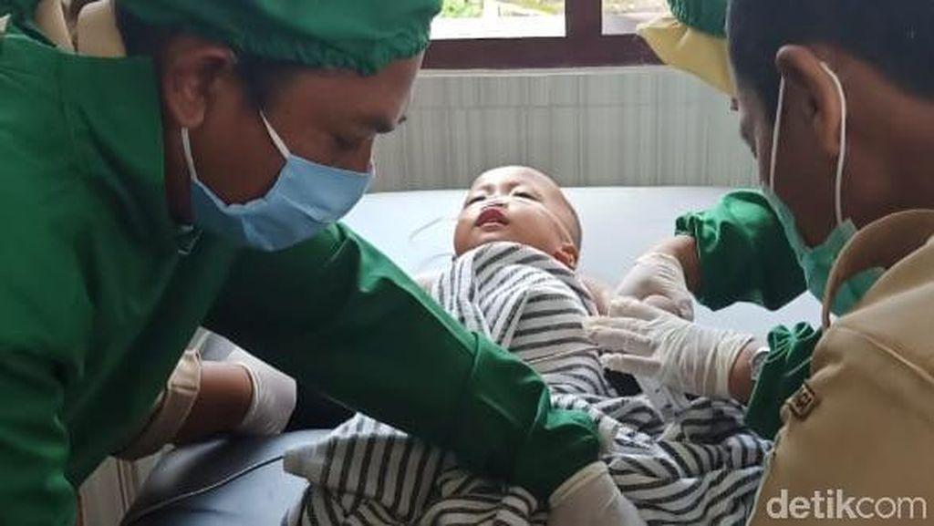 Ajaib, Bayi 18 Bulan Selamat Setelah Sempat Setengah Jam Hanyut di Sungai