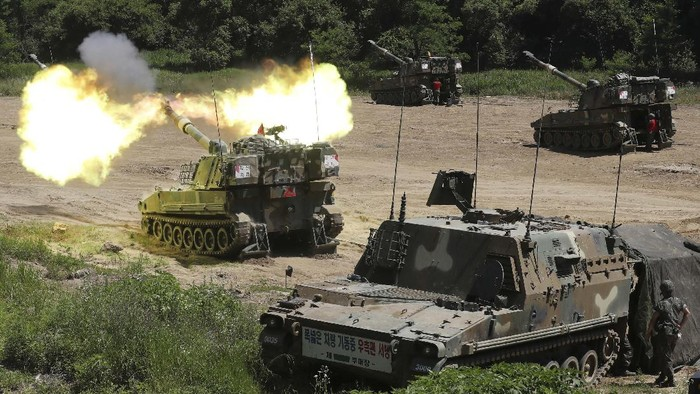 A South Korean army soldier aims his machine gun on his K1E1 tank during a military exercise in Paju near the border with North Korea, South Korea, Thursday, June 18, 2020. South Korea said Thursday it hasn't detected any suspicious activities by North Korea, a day after it threatened with provocative acts at the border in violation of a 2018 agreement to reduce tensions. (Kim Do-hoon/Yonhap via AP)