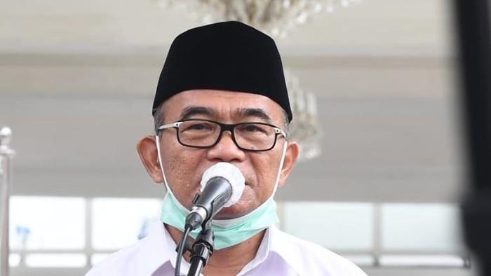 Menko PMK Muhadjir Effendy seusai bertemu Presiden Jokowi di Istana.