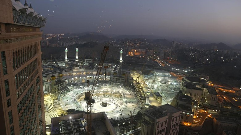FILE - In this March 7, 2020 file photo, the sun sets at the site of the Grand Mosque, in the Muslim holy city of Mecca, Saudi Arabia, as authorities emptied Islams holiest site for sterilization over fears of the new coronavirus. This was supposed to be Saudi Arabias year to shine as host of the prestigious G20 gathering of world leaders. Instead, due to the pandemic, the gathering this November will likely be a virtual meet-up, stripping its host of the pomp that would have accompanied televised arrivals on Riyadhs tarmac. Even the upcoming hajj pilgrimage faces the possibility of being canceled or dramatically pared down. (AP Photo/Amr Nabil, File)
