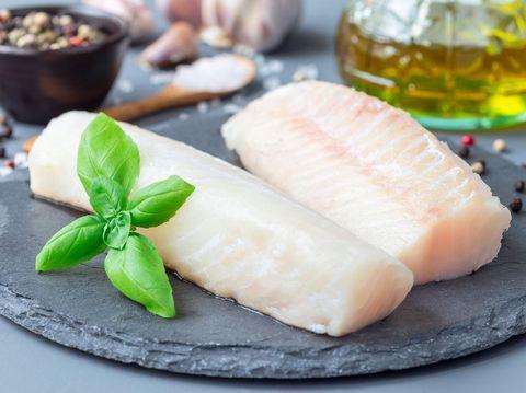 Fresh raw pangasius fish isolated on white background