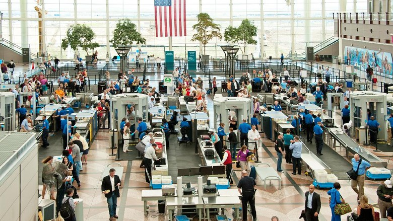 Denver, USA - June 7, 2012: People traveling through security to the gates of Denver International Airport