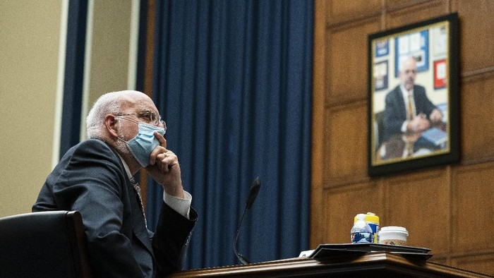 Dr. Robert Redfield, director of the Centers for Disease Control and Prevention listens during a House Committee on Energy and Commerce on the Trump administrations response to the COVID-19 pandemic on Capitol Hill in Washington on Tuesday, June 23, 2020. (Sarah Silbiger/Pool via AP)