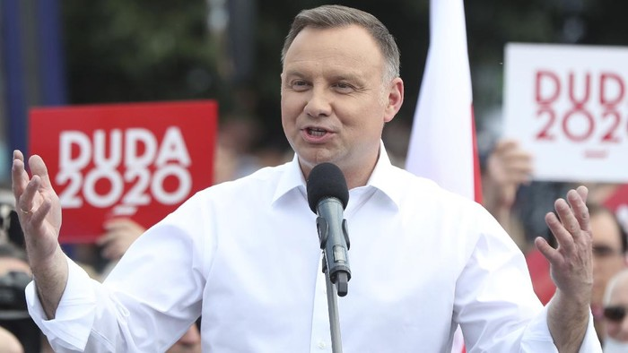 Polish President Andrzej Duda speaks to a crowd as he campaigns ahead of a presidential election later in this month, in Plonsk, Poland, on Tuesday June 16, 2020. Duda is ahead of nine other candidates in opinion polls, but he is not expected to get the 50% needed in the June 28 balloting to avoid a runoff. He is considered most likely to face off in a second round on July 12 against Warsaw mayor Rafal Trzaskowski, whose popularity has been growing.(AP Photo/Czarek Sokolowski)