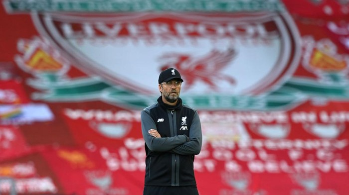 LIVERPOOL, ENGLAND - JUNE 24: Jurgen Klopp, Manager of Liverpool looks on as his team warm up ahead of the Premier League match between Liverpool FC and Crystal Palace at Anfield on June 24, 2020 in Liverpool, England. (Photo by Shaun Botterill/Getty Images)