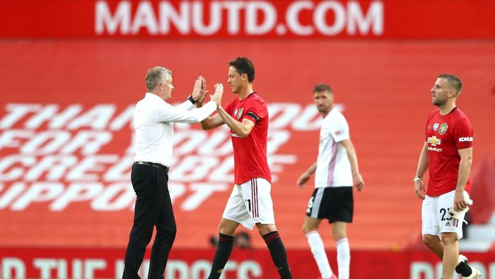 MANCHESTER, ENGLAND - JUNE 24: Ole Gunnar Solskjaer, Manager of anchester United  interacts with Nemanja Matic after the Premier League match between Manchester United and Sheffield United at Old Trafford on June 24, 2020 in Manchester, England. (Photo by Michael Steele/Getty Images)