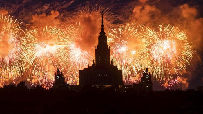 Fireworks explode over Novodevichy Convent to mark the 75th anniversary of the Nazi defeat in WWII, in Moscow, Russia, Wednesday, June 24, 2020. The Victory Day parade normally is held on May 9, the nation's most important secular holiday, but this year it was postponed due to the coronavirus pandemic. (AP Photo/Pavel Golovkin)