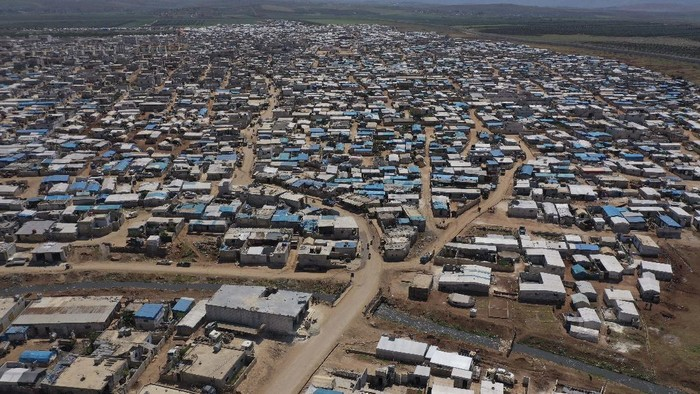 """ATMEH, SYRIA - SEPTEMBER 17: A general view of the Turkish Red Crescent camp near the village of Atmeh, which hosts nearly one million displaced Syrians along the Turkish-Syrian border, September 17, 2019 in Idlib Province, Syria. Turkey's president, Recep Tayyip Erdogan, is pushing for the creation of an expanded """"safe zone"""" in northern Syria where his government hopes to resettle up to three million Syrian refugees. The United States and Turkey recently started joint patrols of a small buffer zone along the border, but it's a far cry from the 20-by-300 mile strip proposed by Mr. Erdogan, and no other power involved in the war as agreed to the idea. Turkey has warned that, if it doesn't receive more international support for the safe zone, it might relax its migration controls and reopen the route for refugees to enter Europe. More than 3.6 million Syrian refugees have settled in Turkey after fleeing the civil war that began in 2011. (Photo by Burak Kara/Getty Images)"""