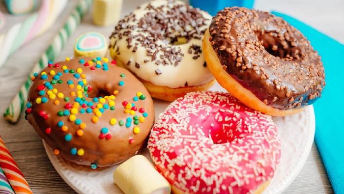 Image of multi colour glazed donuts