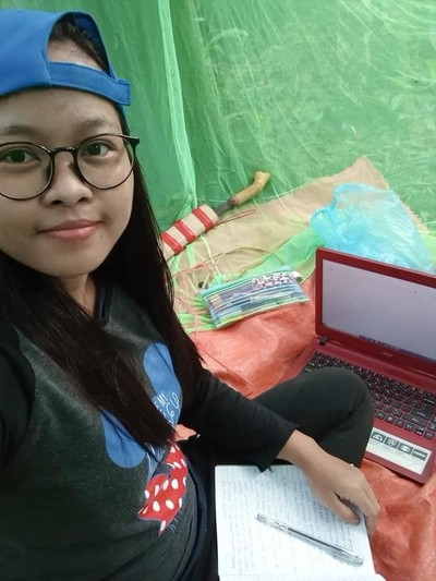 Rose brought a parang along as she sits in the jungle for e-learning. — Photo: Rose Nawie Anjap