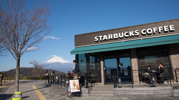 Shizuoka, Japan - February 14, 2015: Starbucks Coffee and Mount Fuji near Fuji River Service area. It is considered one of the most beautiful Starbucks branch in Japan