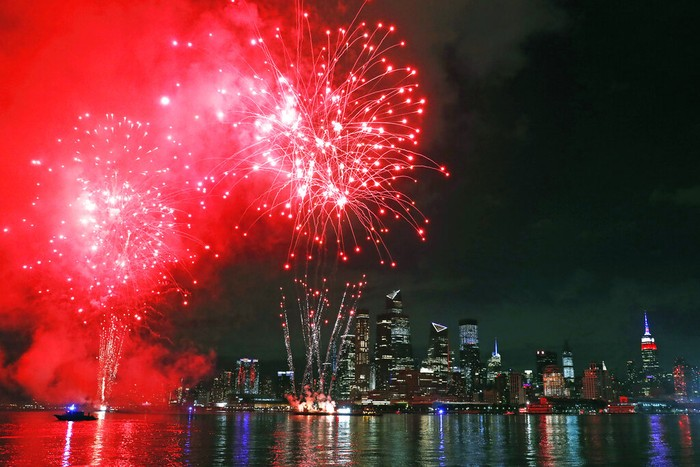Fireworks are launched from near the Hudson Yards area of Manhattan as seen from a pier in Hoboken, N.J., Tuesday, June 30, 2020. The fireworks' location was not announced until about an hour before they began to avoid attracting large crowds during the coronavirus pandemic. (AP Photo/Kathy Willens)