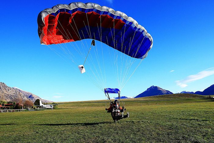QUEENSTOWN, NEW ZEALAND - AUGUST 25:  Derek Livingston of Australia lands during a Winter Games NZ Australian athlete skydive shoot at NZOne on August 25, 2015 in Queenstown, New Zealand.  (Photo by Hannah Peters/Getty Images)