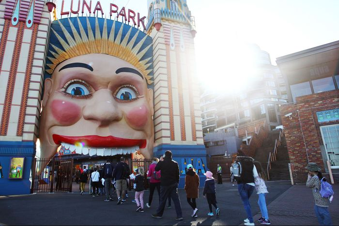 SYDNEY, AUSTRALIA - JULY 03: Showtime performers including Blip the clown and Meringue social distance during a show at Luna Park on July 03, 2020 in Sydney, Australia. Sydneys Luna Park has reopened to the public following its temporary closure on Monday 23 March in response to the COVID-19 pandemic. Restrictions on entertainment venues, weddings, community sport and other gatherings have been eased across NSW since 1 July, but strict physical distancing measures remain in place. (Photo by Lisa Maree Williams/Getty Images)