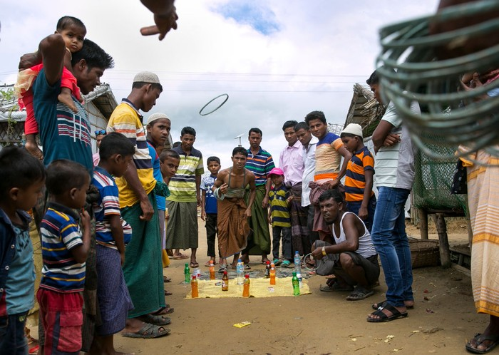 COX'S BAZAR, BANGLADESH -: Rohingya Muslims celebrate at a fair during Eid al-Adha in a refugee camp August 12, 2019 in Cox's Bazar, Bangladesh.  Eid al-Adha, or the Festival of Sacrifice, marks the end of the Hajj pilgrimage to Mecca and in commemoration of Prophet Abraham's readiness to sacrifice his son to show obedience to God. Muslims slaughter a sacrificial animal and split the meat into three parts, one for the family, one for friends and relatives, and one for the poor and needy. (Photo by Allison Joyce/Getty Images)