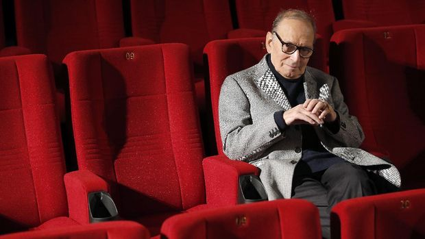 "FILE - In this Dec. 6, 2013 file photo, Italian composer Ennio Morricone poses during a photo call to promote his German 2014 concerts, in Berlin, Germany. Morricone, who created the coyote-howl theme for the iconic Spaghetti Western ""The Good, the Bad and the Ugly"" and the soundtracks such classic Hollywood gangster movies as ""The Untouchables,"" died Monday, July 6, 2020 in a Rome hospital at the age of 91. (AP Photo/Michael Sohn, file)"