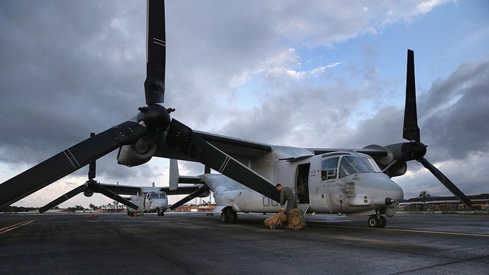 MONROVIA, LIBERIA - OCTOBER 09:  A U.S. Marine deplanes after arriving on an MV-22 Osprey to take part in Operation United Assistance on October 9, 2014 in Monrovia, Liberia. Some 90 Marines arrived on KC-130 transport planes and the Ospreys to support the American effort to contain the Ebola epidemic. The four Ospreys, which can land vertically like helicopters, will transport U.S. troops and supplies as they build 17 Ebola treatment centers around Liberia.  U.S. President Barack Obama has committed up to 4,000 troops in West Africa to combat the disease.  (Photo by John Moore/Getty Images)