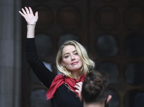 Actress Amber Heard, center, arrives at the High Court in London, Tuesday, July 7, 2020. Johnny Depp has a starring role in a real-life courtroom drama in London, where he is suing a tabloid newspaper for libel over an article that branded him a