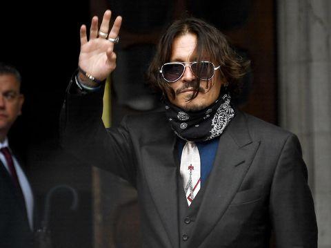 Johnny Depp hadir di Pengadilan Tinggi London, Rabu (8/8/2020) untuk persidangan pencemaran nama baik melawan tabloid The Sun. Foto: AP Photo/Alberto Pezzali