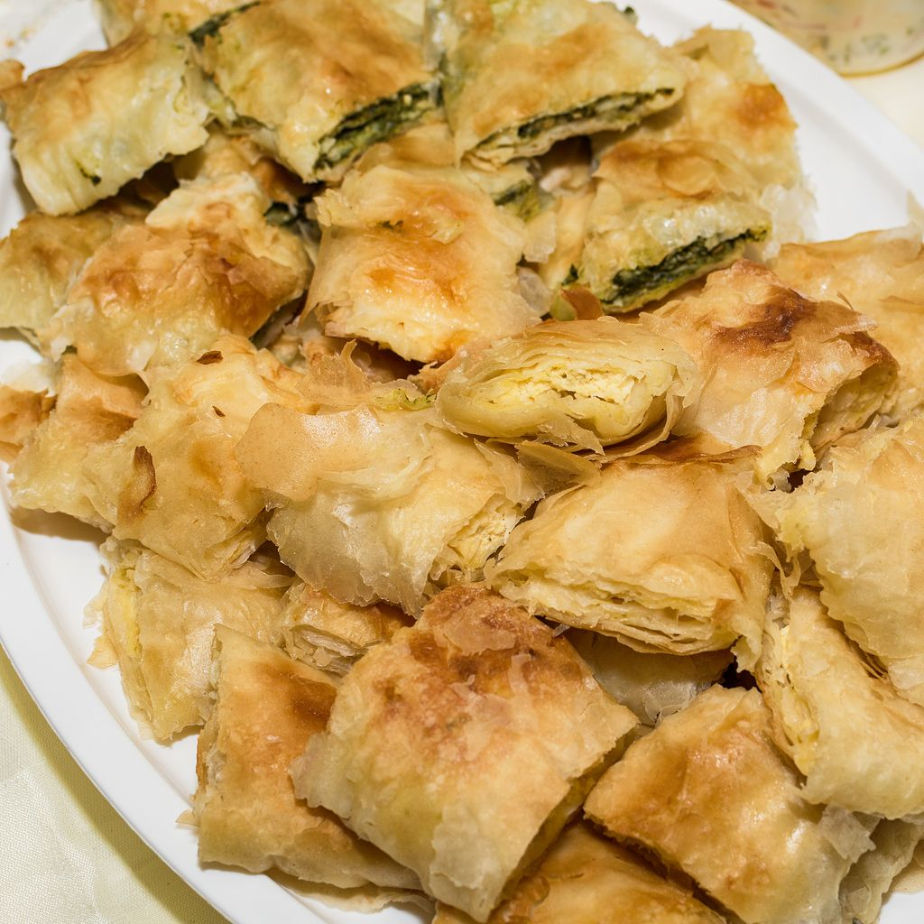 Traditional Serbian cheese pie gibanica and spinach pie in plate