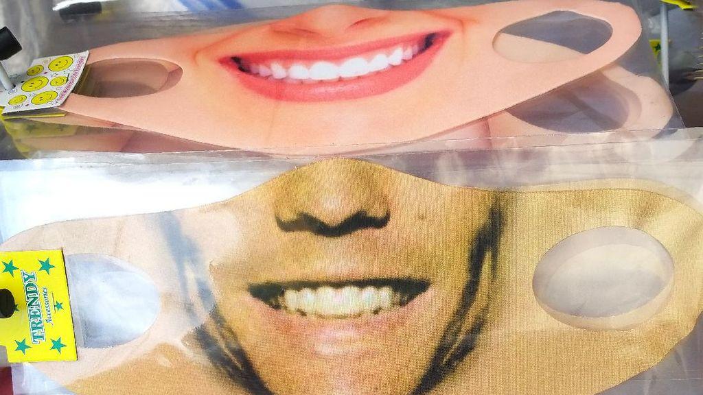 Penjual Masker Gambar Wajah Raup Keuntungan di Tengah Pandemi