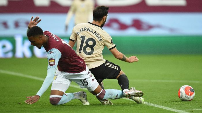 BIRMINGHAM, ENGLAND - JULY 09: Bruno Fernandes of Manchester United is fouled by Ezri Konsa Ngoyo of Aston Villa and a penalty is awarded during the Premier League match between Aston Villa and Manchester United at Villa Park on July 09, 2020 in Birmingham, England. Football Stadiums around Europe remain empty due to the Coronavirus Pandemic as Government social distancing laws prohibit fans inside venues resulting in all fixtures being played behind closed doors. (Photo by Oli Scarff/Pool via Getty Images)