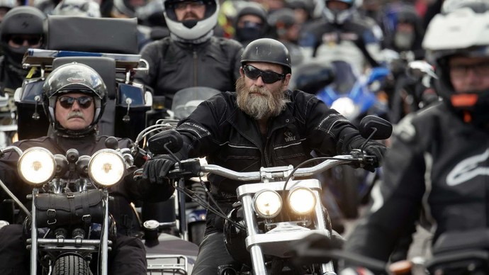 With their motorcycles people attend a demonstration against planned biker driving bans in Leipzig, eastern Germany, Sunday, July 12, 2020. The background of the nationwide biker protests are demands by the Federal Council to reduce motorcycle noise. (AP Photo/Jens Meyer)