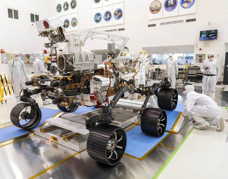 FILE - In this Thursday, Nov. 14, 2019 file photo, a Mars lander is lifted during a test for its hovering, obstacle avoidance and deceleration capabilities at a facility at Huailai in Chinas Hebei province. The site outside Beijing simulated conditions on the red planet, where the pull of gravity is about one-third that of Earth. China will launch their Mars rover and an orbiter sometime around July 23, 2020, in a mission named Tianwen, or Questions for Heaven. (AP Photo/Andy Wong)