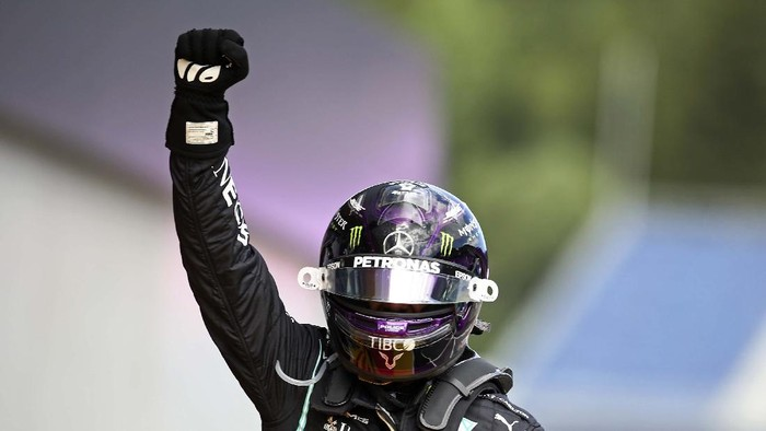 Mercedes driver Lewis Hamilton of Britain reacts alone on the podium after winning the Styrian Formula One Grand Prix race at the Red Bull Ring racetrack in Spielberg, Austria, Sunday, July 12, 2020. (Leonhard Foeger/Pool via AP)
