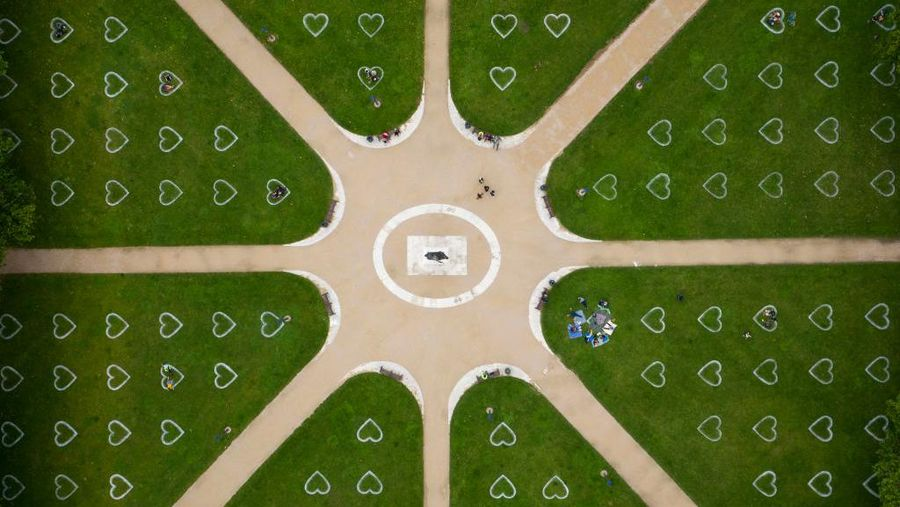 BRISTOL, ENGLAND - JULY 08: An aerial view of Queen Square where hearts have been sprayed onto the grass in an effort to encourage social distancing on July 8, 2020 in Bristol, England. England has continued its phased easing of lockdown restrictions by reopening restaurants, pubs and hairdressing salons while the two-metre social distancing rule has been revised to 1m+. (Photo by Matthew Horwood/Getty Images)