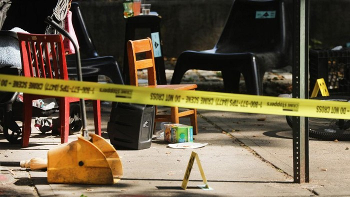 NEW YORK, NEW YORK - JULY 13: Police ballistic markers stand besides a childs chair and bicycle at a crime scene in Brooklyn where a one year old child was shot and killed on July 13, 2020 in New York City. The 1-year-old boy was shot near a playground during a Sunday picnic when gunfire erupted. Two other adults were wounded in the evening shooting. New York City has witnessed a surge in gun violence over the past month with 9 people killed, including children, and 41 others wounded on the Fourth of July weekend alone. The gun violence is occurring against the backdrop of a nationwide movement to consider defunding police departments.   Spencer Platt/Getty Images/AFP