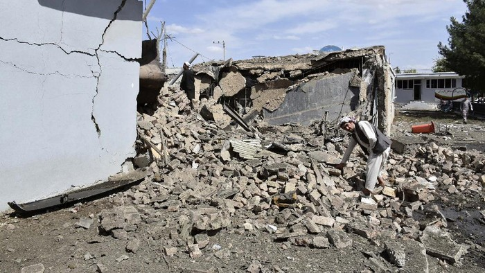 Afghan security personnel inspect the site of a car bomb blast on an intelligence compound in Aybak, the capital of the Samangan province in northern Afghanistan, Monday, July 13, 2020. Taliban insurgents launched a complex attack on the compound that began with a suicide bombing, officials said. (AP Photo)