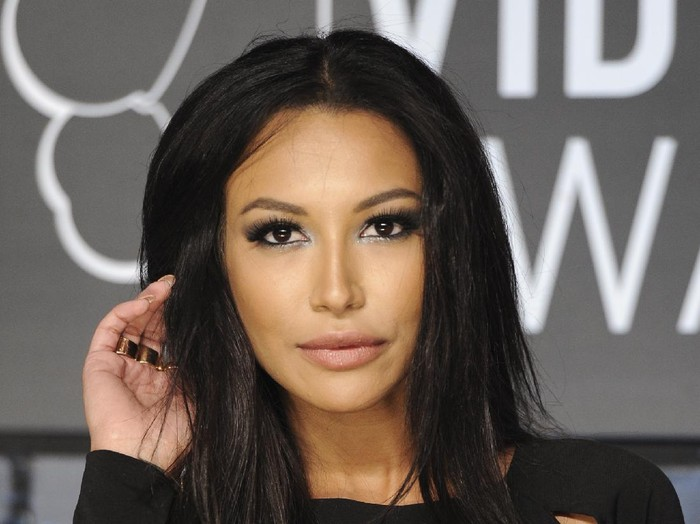 FILE - Actress Naya Rivera, from the Fox series Glee arrives at the MTV Video Music Awards in New York on Aug. 25, 2013. Authorities say a body has been found at a Southern California lake during the search for Rivera. The Ventura County Sheriff's Office says in a tweet that the body was found Monday morning, July 13, 2020, in the search of Lake Piru, five days after Riveras 4-year-old son was found alone in a boat the two had rented. (Photo by Evan Agostini/Invision/AP, File)