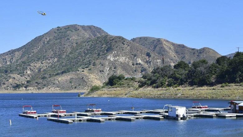Third boat from left, cordoned off with police tape, is believed to be the boat actress Naya Rivera and her son rented on July 8 as the search for her body continues at Lake Piru in the Los Padres National Forest, Ventura County, California on July 9, 2020. -