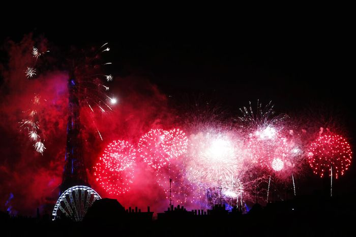 Fireworks illuminate the Paris roofs during Bastille Day celebrations late Tuesday, July 14, 2020. (AP Photo/Thibault Camus)