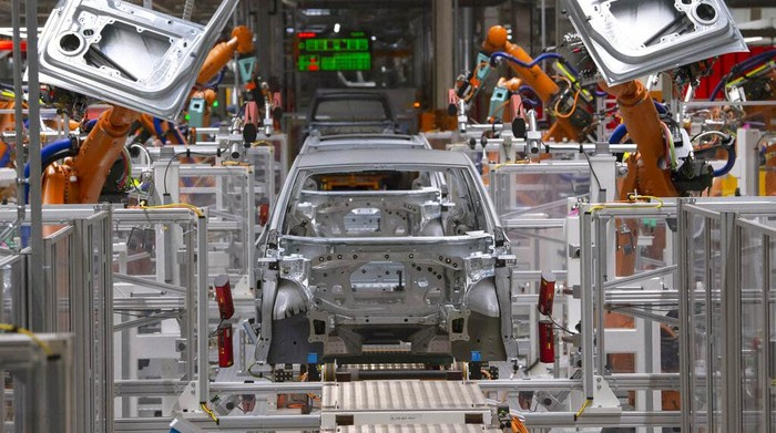FILE- In this Tuesday, Feb. 25, 2020 file photo, workers complete an electric car ID.3 body at the assembly line during a press tour at the plant of the German manufacturer Volkswagen AG (VW) in Zwickau, Germany. The coronavirus has cancelled business plans all over the world but Europes push into electric cars isnt one of them. Sales of battery-powered and hybrid cars have held up despite a deeply painful recession, mainly thanks to the action of governments. (AP Photo/Jens Meyer, file)