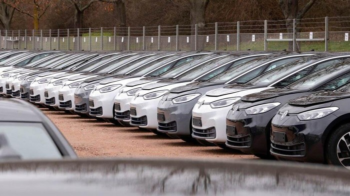 FILE- In this Tuesday, Feb. 25, 2020 file photo, workers complete an electric car ID.3 body at the assembly line during a press tour at the plant of the German manufacturer Volkswagen AG (VW) in Zwickau, Germany. The coronavirus has cancelled business plans all over the world but Europe's push into electric cars isn't one of them. Sales of battery-powered and hybrid cars have held up despite a deeply painful recession, mainly thanks to the action of governments. (AP Photo/Jens Meyer, file)