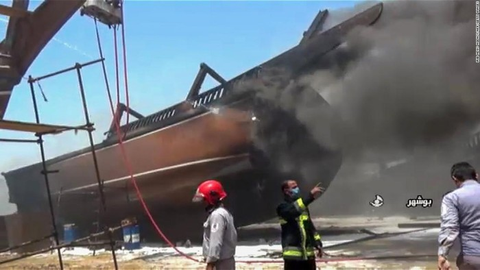 A screen grab taken from a from Iranian State TV IRIB on Wednesday showing firefighters combating a blaze at a shipyard in the Iranian city of Bushehr.