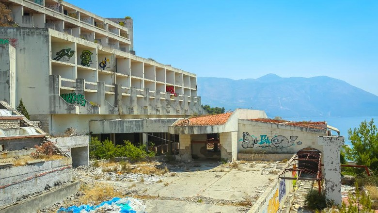 Kupari, Croatia- July 19, 2017 : The exterior of an old ruined hotel Goricina in abandoned Yugoslavian military resort in Kupari, Croatia.