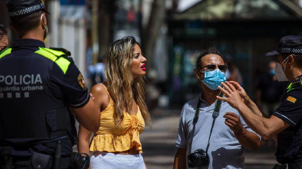 Spanyol Bisa Wajibkan Masker dan Social Distancing Sampai 2022