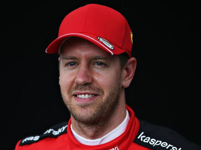 MELBOURNE, AUSTRALIA - MARCH 12: Sebastian Vettel of Germany and Ferrari poses for a photo in the Paddock during previews ahead of the F1 Grand Prix of Australia at Melbourne Grand Prix Circuit on March 12, 2020 in Melbourne, Australia. (Photo by Charles Coates/Getty Images)