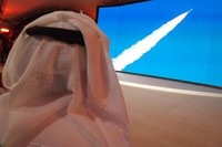 An Emirati man prepares to watch the launch of the