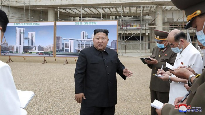 In this undated photo provided on Monday, July 20, 2020 by the North Korean government, North Korean leader Kim Jong Un, center, visits a construction site of a hospital in Pyongyang, North Korea. Independent journalists were not given access to cover the event depicted in this image distributed by the North Korean government. The content of this image is as provided and cannot be independently verified. Korean language watermark on image as provided by source reads:
