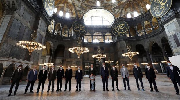 Turkey's President Recep Tayyip Erdogan, center, and other officials visit the Byzantine-era Hagia Sophia, one of Istanbul's main tourist attractions in the historic Sultanahmet district of Istanbul, Sunday, July 19, 2020, days after he formally reconverted Hagia Sophia into a mosque and declared it open for Muslim worship, after a high court annulled a 1934 decision that had made the religious landmark a museum.(Turkish Presidency via AP, Pool)