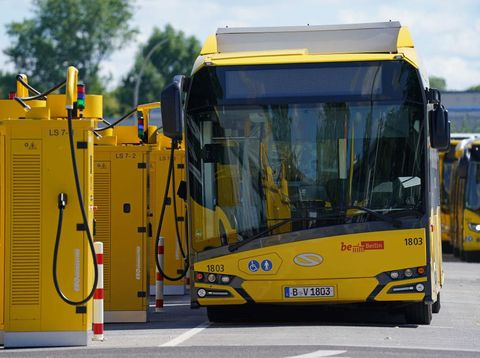 BERLIN, GERMANY - JULY 21: Electric buses stand charging at a yard of the BVG Berlin public transport authority on July 21, 2020 in Berlin, Germany. The city of Berlin is expanding its fleet of electric buses with the goal of having 250 running by the end of 2021 and to have its entire fleet be solely electric within ten years. Cities across Europe are pursuing measures to decrease their carbon footprint and rein in global warming.  (Photo by Sean Gallup/Getty Images)