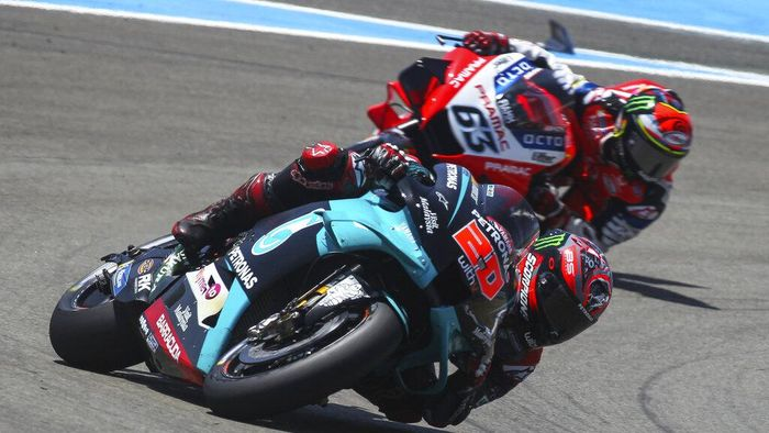 MotoGP rider Fabio Quartararo of France steers his motorbike ahead of Francesco Bagnaia of Italy, during the Spanish Motorcycle Grand Prix at the Angel Nieto racetrack in Jerez de la Frontera, Spain, Sunday, July 19, 2020. (AP Photo/David Clares)