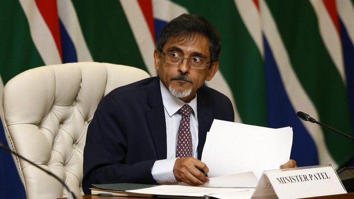 (FILES) In this file photo taken on March 24, 2020 South African Trade and Industry Minister Ebrahim Patel looks on during a press conference with Members of the National Command Councils Economic Cluster to outline in detail governments intervention measures on COVID-19 coronavirus at the OR Tambo Building in Pretoria. - Patel on July 25, 2020 tested positive for COVID-19, the cabinet said, the fourth minister to contract the virus in Africas hardest-hit country. Cabinet spokeswoman Phumla Williams said in a statement that Patel, 58, received his results on July 25. (Photo by Phill Magakoe / POOL / AFP)