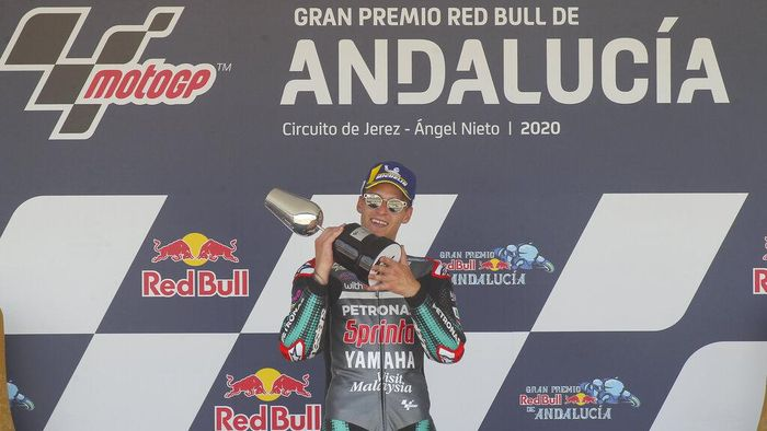 Yamaha rider Fabio Quartararo of France holds the trophy after winning the MotoGP race during the Andalucia Motorcycle Grand Prix at the Angel Nieto racetrack in Jerez de la Frontera, Spain, Sunday July 26, 2020. (AP Photo/David Clares)